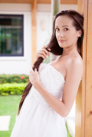 beautiful young brunette woman with long hair relaxing outdoor Stock Photo - 16987609