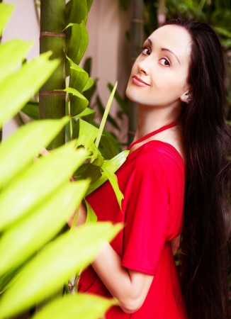 beautiful young brunette woman with long hair in the garden Stock Photo - 16987624