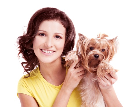 beautiful young woman with a dog, isolated against wite background photo