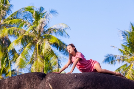 outsides: beautiful young woman relaxing at the tropical resort Stock Photo
