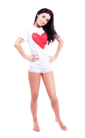 women s legs: beautiful young woman wearing a  shirt with a big red heart, isolated against white background Stock Photo