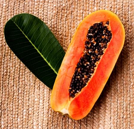 papaya tree: juicy papaya and a leaf of a tropical tree