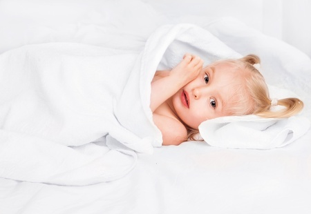 cute two year old girl wrapped into towels after taking a bath  Stock Photo - 19632844