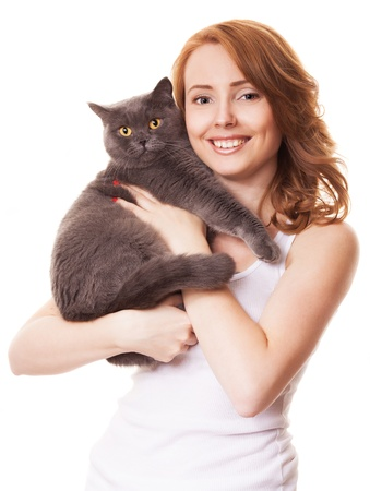 smiling cat: beautiful young woman holding a cat, isolated against white background Stock Photo
