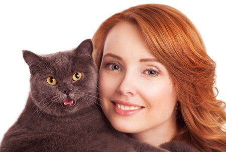 beautiful young woman holding a cat, isolated against white background photo