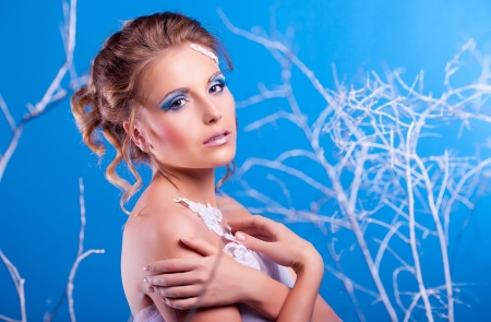 beautiful young woman with bright makeup (winter topic) photo