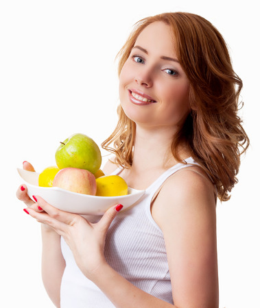 young woman with apples, isolated against white background photo