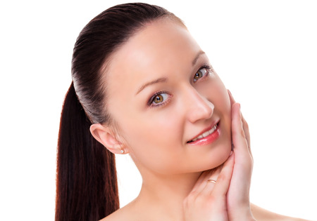 pores: beautiful young woman with healthy beautiful skin and natural makeup, touching her face, isolated against white background