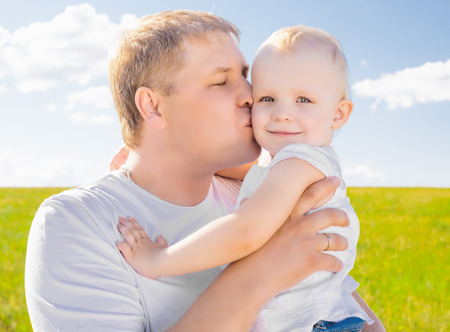 outsides: young father with her daughter outdoor on a summer day Stock Photo
