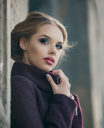 beauty woman: beautiful woman with bright makeup wearing a warm jacket in the street