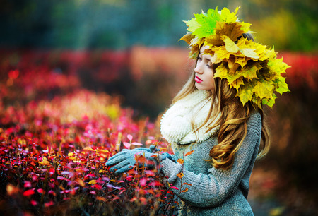 beautiful young woman in the autumn park photo