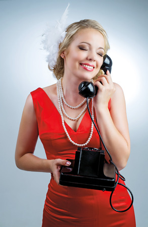 beautiful young blond woman with a telephone, retro style photo