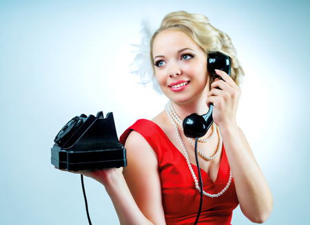 retro phone: beautiful young blond woman with a telephone, retro style Stock Photo