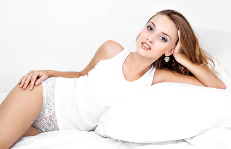 teen girl underwear: beautiful young woman in bed at home