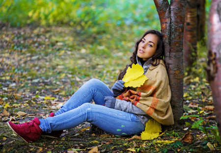 long depression: beautiful young brunette woman having a walk in the autumn park Stock Photo
