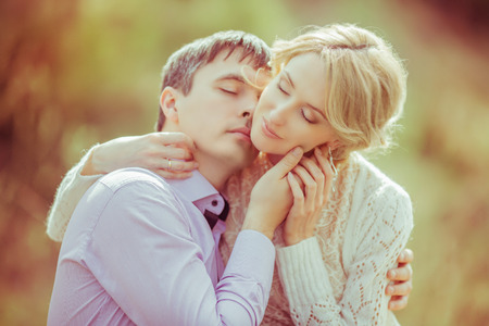outsides: happy loving couple in the summer park Stock Photo