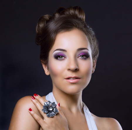 night out: young brunette woman with beautiful makeup and hair, wearing a silver ring Stock Photo