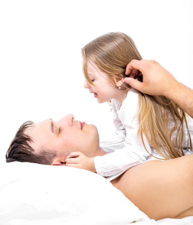 father and his five years old daughter, in bed at home photo