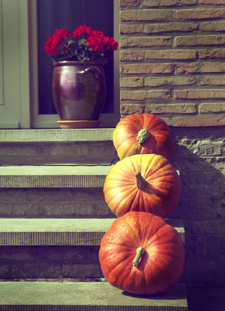harvest time: pumpkings on the porch of the house, harvest time Stock Photo