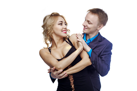 cha: happy young couple dancing, isolated against white studio background