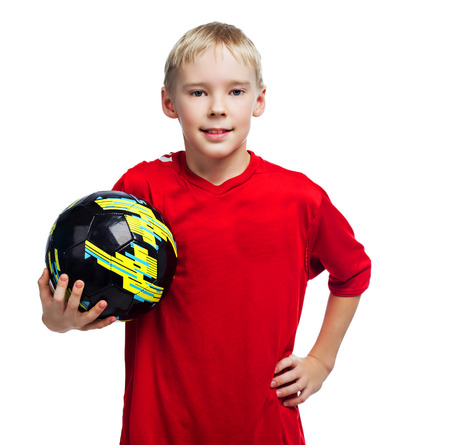 nine year old: nine year old boy dressed as a football player, isolated against white studio background Stock Photo