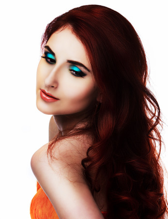 beautiful young model with red hair and bright makeup, isolated against white background