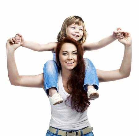 shoulder ride: happy laughing mother and her son isolated against white studio background