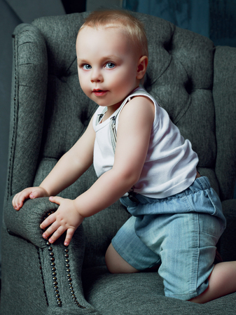 passtime: one and a half year old boy in the chair at home