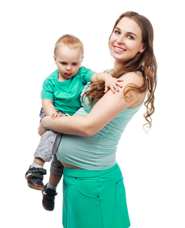 one year: happy beautiful pregnant mother with her one year old son, studio shot Stock Photo