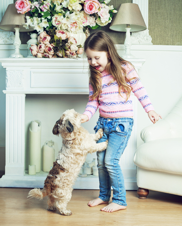 girl home: happy girl with her dog at home Stock Photo