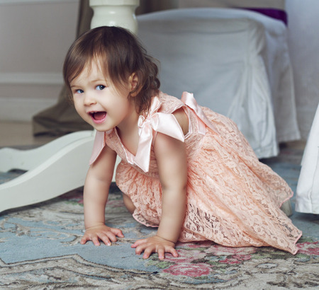 insides: happy smiling baby on the floor at home