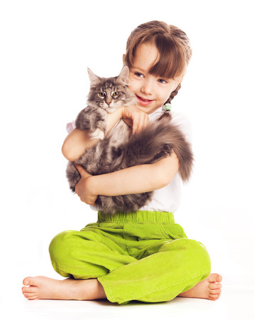girl with a cat isolated against white studio background photo