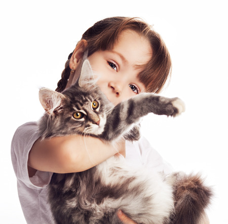 carry on: girl with a cat isolated against white studio background