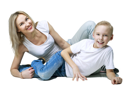motherhood: happy smiling mother and son, isolated against white background Stock Photo