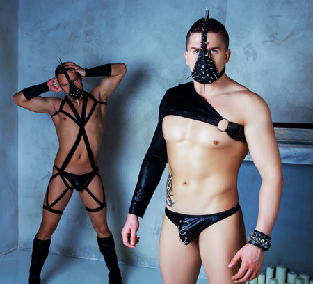 beautiful bdsm: dancers wearing leather costumes and masks, in the studio