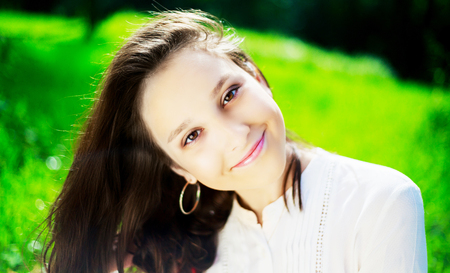 brown eyes: pretty teenage girl outdoor on a summer day Stock Photo