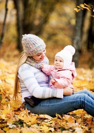 happy mother and baby in the autumn park
