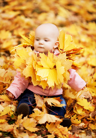 happy  baby outdoor in the autumn park
