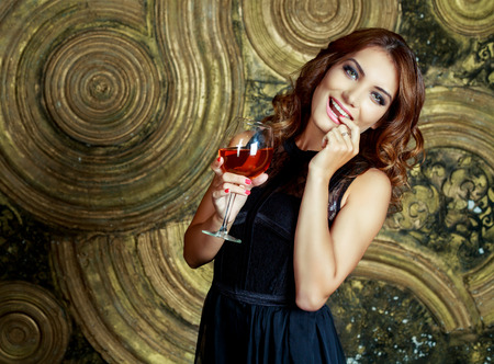 wine glass: beautiful young woman with a glass of wine