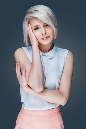 ache: beautiful woman having head ache, isolated Stock Photo
