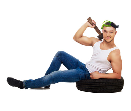 insides: dancer dressed as car mechanic with tools and tire, isolated against white background