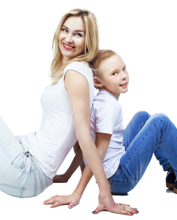 happy smiling mother and son, isolated against white background photo