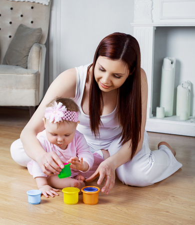insides: happy mother and her baby playing at home Stock Photo