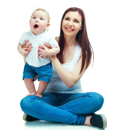 insides: happy mother and her baby isolated against white background Stock Photo