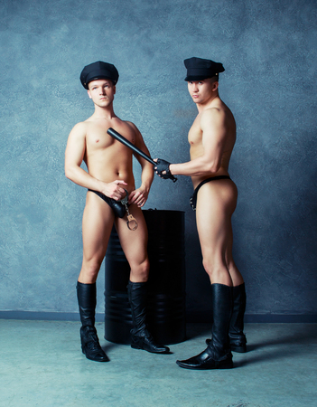 hait: striptease dancers wearing costumes of policemen in the studio