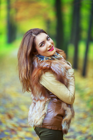 female sexuality: beautiful young woman   in the autumn park outdoor