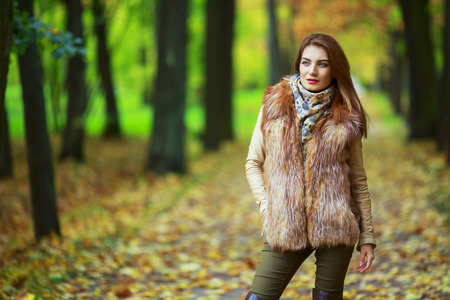 beautiful young woman   in the autumn park outdoor