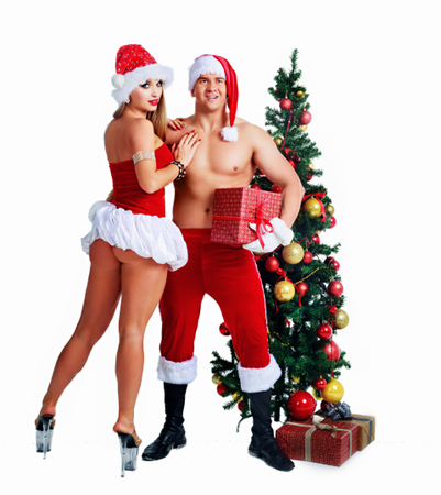 beautiful young man and woman striptease dancers wearing Santas clothes with Christmas tree in the studio