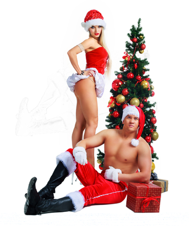 beautiful young man and woman wearing Santas clothes with Christmas tree in the studio
