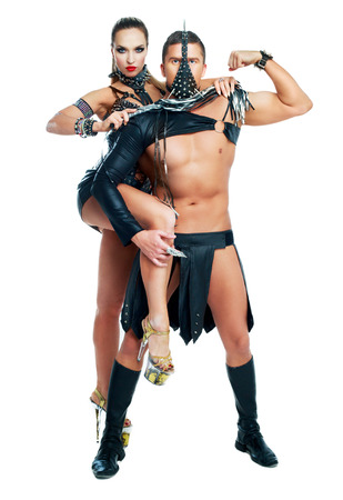two young striptease dancers wearing leather isolated against white studio background Stock Photo